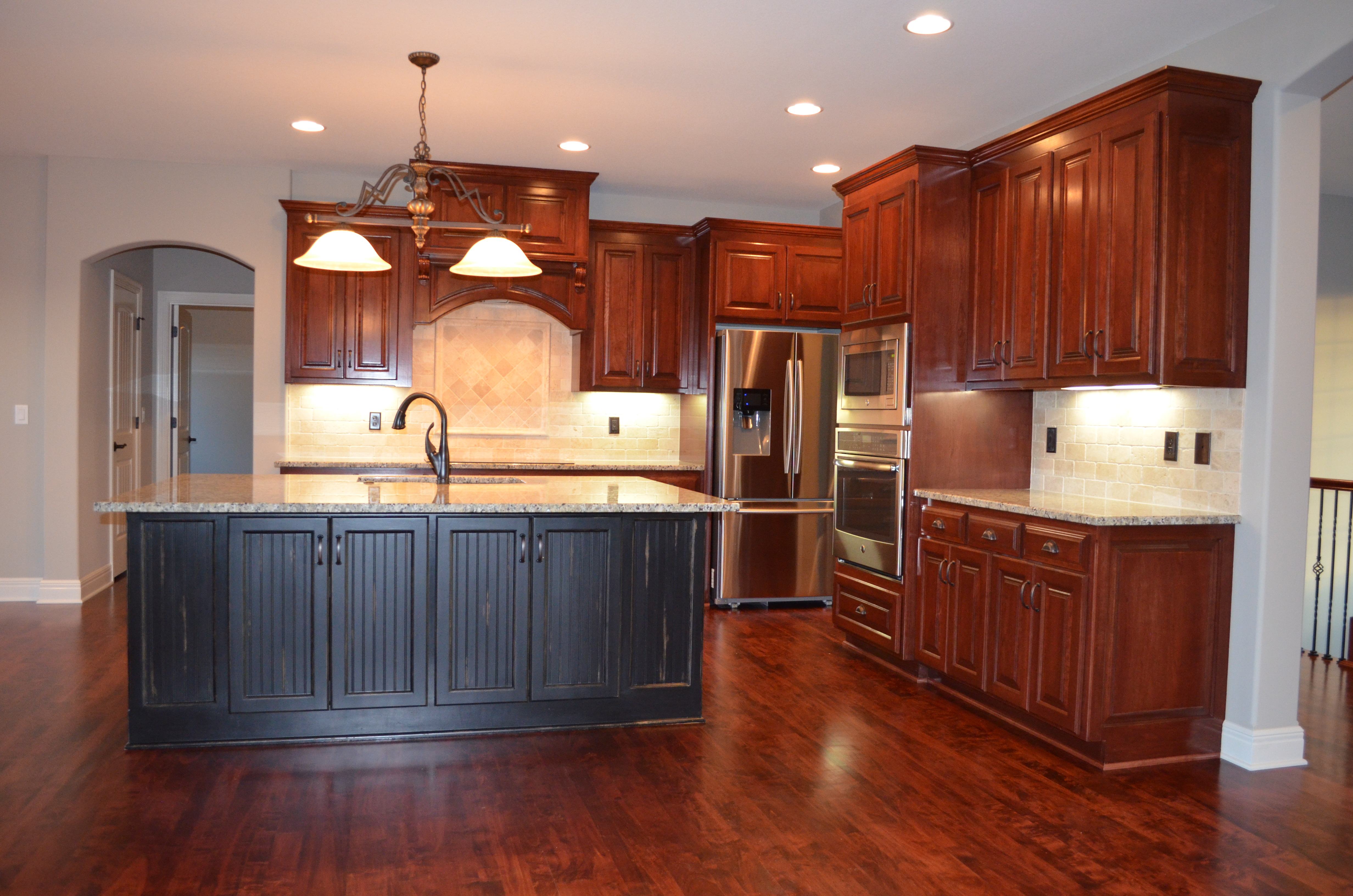 Sweetwater Creek New Homes in Spring Hill, KS Kitchen with Stained Cabinetry