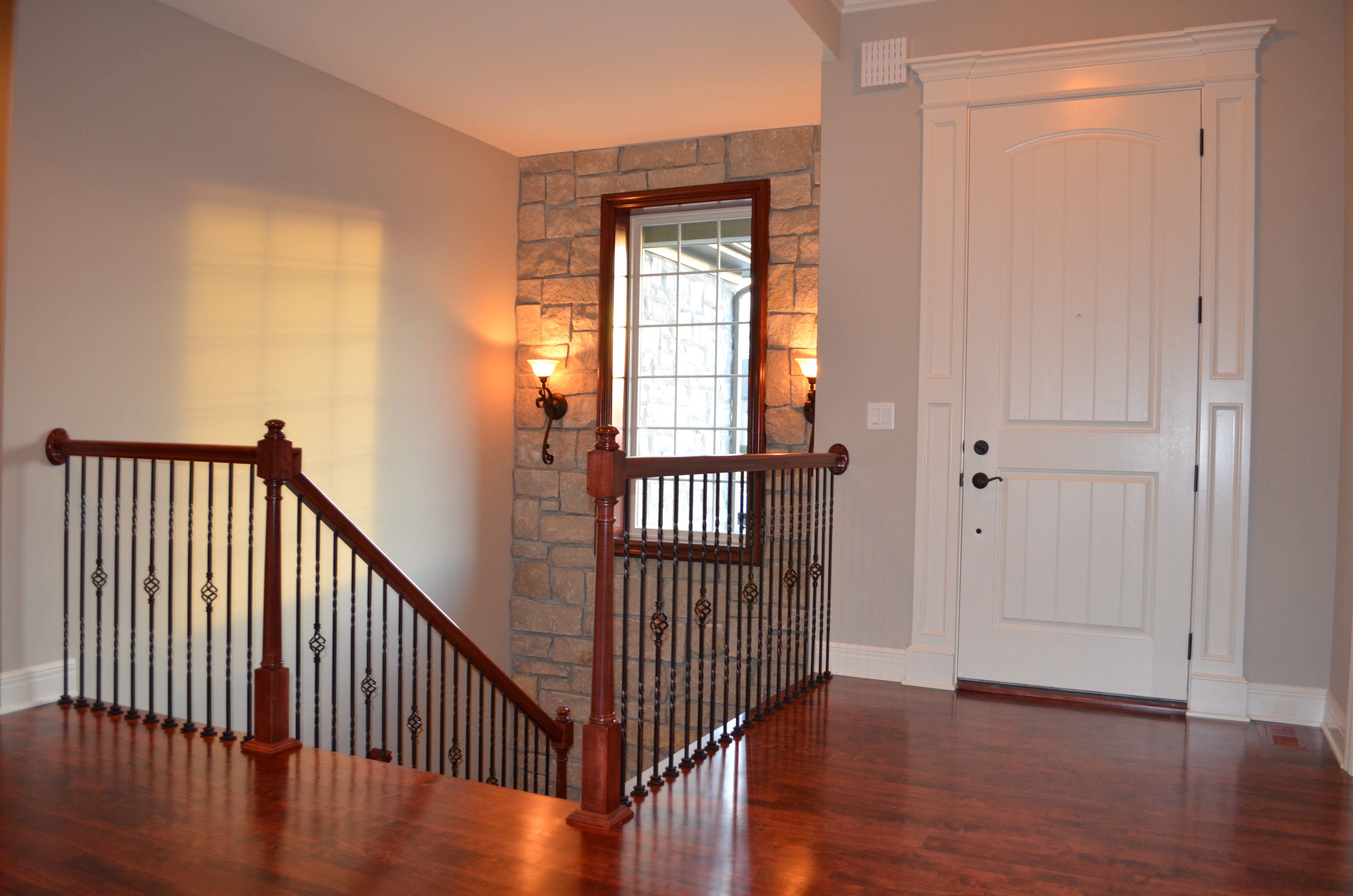 Sweetwater Creek New Homes in Spring Hill, KS Stairway with Stone Accent