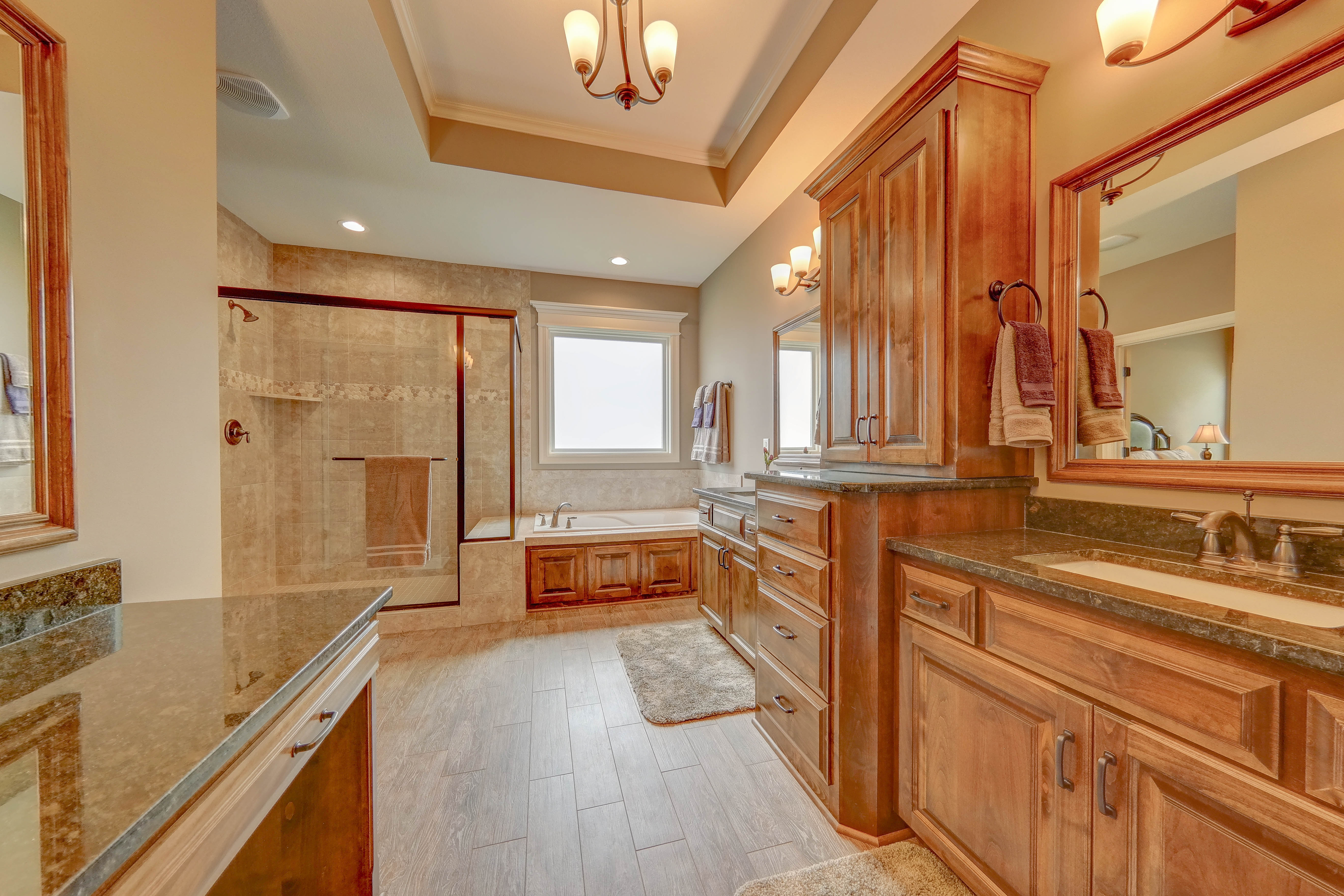 Sweetwater Creek New Homes in Spring Hill, KS Master Bathroom with Stained Cabinetry