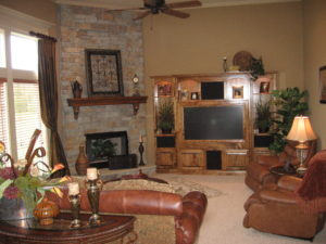 Sweetwater Creek New Homes in Spring Hill, KS Living Room with Stone Fireplace